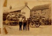 "Ancroft, Farm workers and families outside the Lamb Inn on ""Flitting""day"