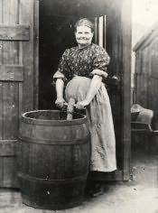 Cramlington, Mrs. Dormand with her washing - Click for bigger image