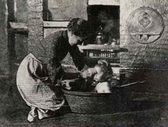 Picture of Cramlington, Mrs. Nellie Robson bathing her daughter Annie