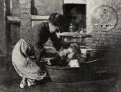 Cramlington, Mrs. Nellie Robson bathing her daughter Annie - Click for bigger image